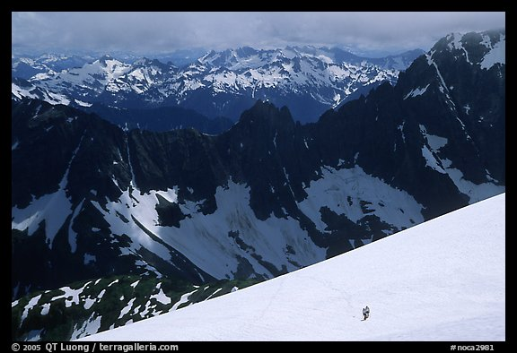 Mountain ridges, and mountaineers on snow field, North Cascades National Park. Washington, USA.