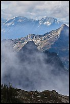 Peaks partly obscured by clouds, North Cascades National Park.  ( color)