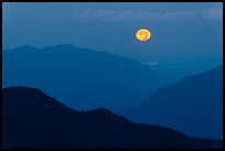 Moon setting over ridges, North Cascades National Park. Washington, USA.