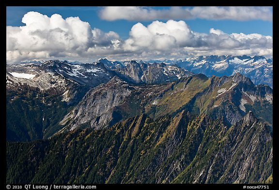 Mountains and afternoon cumulus clouds, North Cascades National Park.  (color)