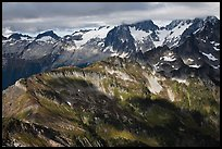 Cloud-capped mountains in dabbled light, North Cascades National Park. Washington, USA.