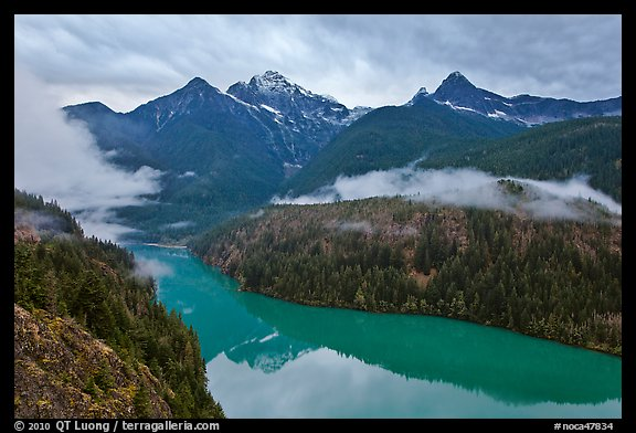 Colonial Peak and Pyramid Peak above Diablo Lake on rainy evening, North Cascades National Park Service Complex.  (color)