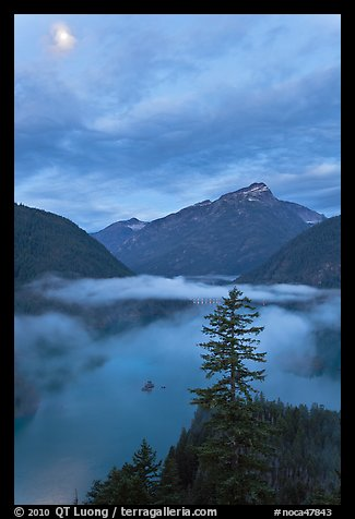 Diablo Lake, fog, and moon, dawn, North Cascades National Park Service Complex. Washington, USA.