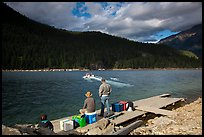 Guests waiting for ride across lake to Ross Lake resort, North Cascades National Park Service Complex.  ( color)