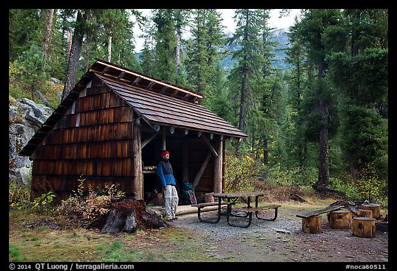 Hiker at high Bridge campground shelter, North Cascades National Park.  (color)