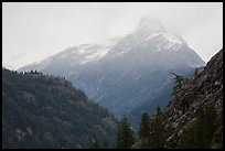 Snow-capped jagged peak in clouds, North Cascades National Park.  ( color)