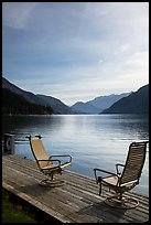 Two chairs on the shore of Lake Chelan, Stehekin, North Cascades National Park Service Complex. Washington, USA.