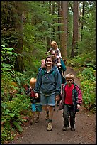 Family walking on forest trail. Olympic National Park, Washington, USA.