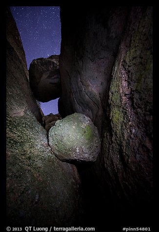 Boulders wedged in Balconies Cave at night. Pinnacles National Park (color)