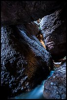 Stream and boulders, Upper Bear Gulch cave. Pinnacles National Park ( color)