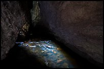 Light on stream in dark cave. Pinnacles National Park ( color)