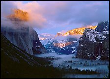 View with fog in valley and peaks lighted by sunset, winter. Yosemite National Park, California, USA. (color)