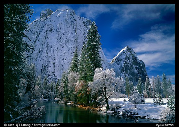Cathedral rocks and Merced River with fresh snow. Yosemite National Park, California, USA.