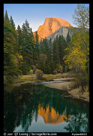 Half Dome reflected in Merced River at sunset. Yosemite National Park, California, USA.