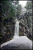 Snow-covered boulder and base of Chilnualna Falls. Yosemite National Park ( color)