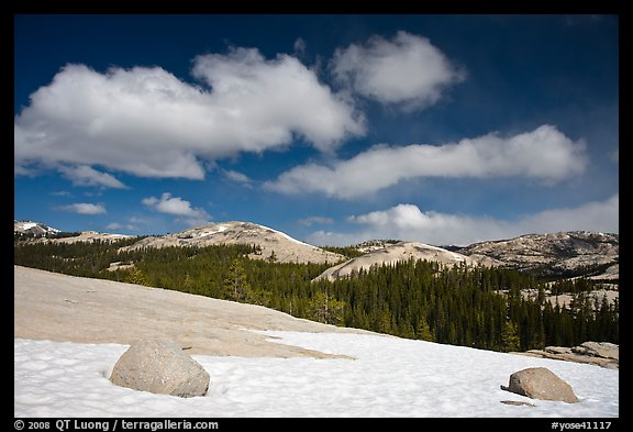 Snow on slab, boulders, and distant domes, Tuolumne Meadows. Yosemite National Park (color)
