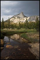 Cathedral Peak reflected in stream under stormy skies. Yosemite National Park ( color)
