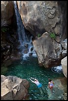 Swimmers in a pool at the base of Wapama falls, Hetch Hetchy. Yosemite National Park, California, USA. (color)
