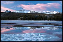 Peaks reflected in snow melt pool, Twolumne Meadows, sunset. Yosemite National Park ( color)
