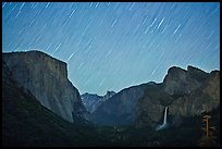 Yosemite Valley by night with star trails. Yosemite National Park ( color)