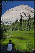 Hiker sitting at Lost Lake on west side Half-Dome. Yosemite National Park ( color)
