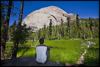 Hiker looking at backside of Half-Dome from Lost Lake. Yosemite National Park ( color)