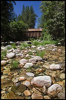 Pebbles in river and covered bridge, Wawona. Yosemite National Park, California, USA. (color)