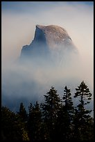 Half-Dome emerging from smoke at night. Yosemite National Park ( color)