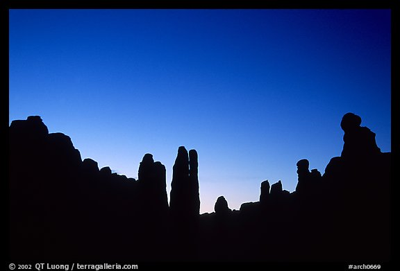 Sandstone pillars in Klondike Bluffs seen as silhouettes at dusk. Arches National Park (color)