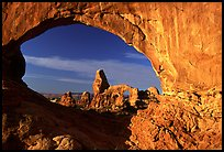 Turret Arch seen through South Window, sunrise. Arches National Park, Utah, USA.