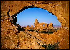 Turret Arch seen from rock opening. Arches National Park, Utah, USA.