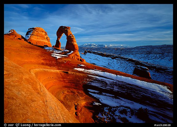 Sandstone bowl, Delicate Arch, and La Sal Mountains with snow, sunset. Arches National Park (color)