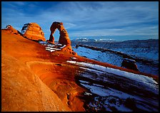 Sandstone bowl, Delicate Arch, and La Sal Mountains with snow, sunset. Arches National Park ( color)