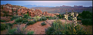 Fiery Furnace sandstone fins and mountains at dusk. Arches National Park (Panoramic color)