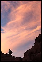 Sunset clouds and small balanced rock. Arches National Park, Utah, USA. (color)