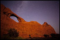 Skyline Arch at night with starry sky. Arches National Park, Utah, USA.