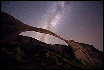Landscape Arch bissected by Milky Way. Arches National Park, Utah, USA.