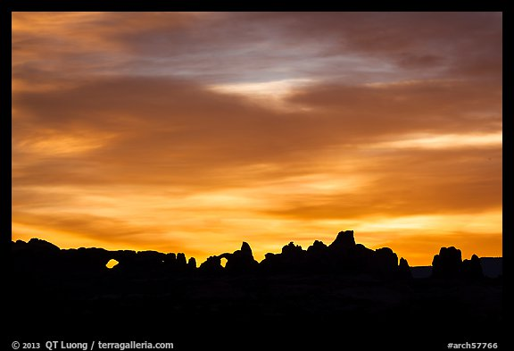 Windows and Turret Arch silhouetted at sunrise. Arches National Park (color)