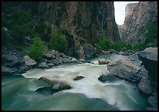 Gunisson River flowing beneath steep canyon walls. Black Canyon of the Gunnison National Park ( color)