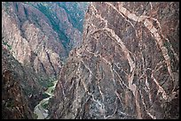 Sheer cliff with flourishes of crystalline pegmatite. Black Canyon of the Gunnison National Park, Colorado, USA. (color)