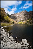 Gunnison River shore and cliffs at East Portal in the fall. Black Canyon of the Gunnison National Park ( color)