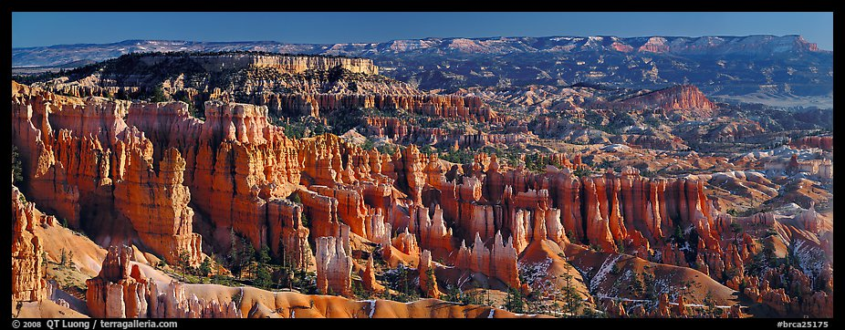 Densely aligned pinnacles in horseshoe-shaped amphitheaters along edge of Pausaugunt Plateau. Bryce Canyon National Park (color)