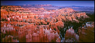 Innumerable brighly colored free-standing hoodoos aligned in amphiteater. Bryce Canyon National Park (Panoramic color)