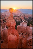 Sun rising behind Thor Hammer. Bryce Canyon National Park ( color)