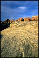 Sandstone striations and Needles near Elephant Hill, sunrise. Canyonlands National Park ( color)