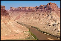 Distant views of rafts floating Colorado River. Canyonlands National Park, Utah, USA.