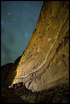 Illuminated canyon wall with rock art under starry sky, Horseshoe Canyon. Canyonlands National Park, Utah, USA. (color)