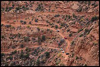 Jeep caravan negotiates hairpin turn on the Flint Trail,  Orange Cliffs Unit, Glen Canyon National Recreation Area, Utah. USA ( color)