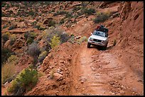 High clearance four-wheel-drive vehicle on the Flint Trail,  Orange Cliffs Unit,  Glen Canyon National Recreation Area, Utah. USA ( color)
