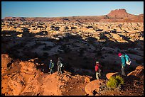 Hikers on Petes Mesa ridge above the Maze. Canyonlands National Park, Utah, USA. (color)